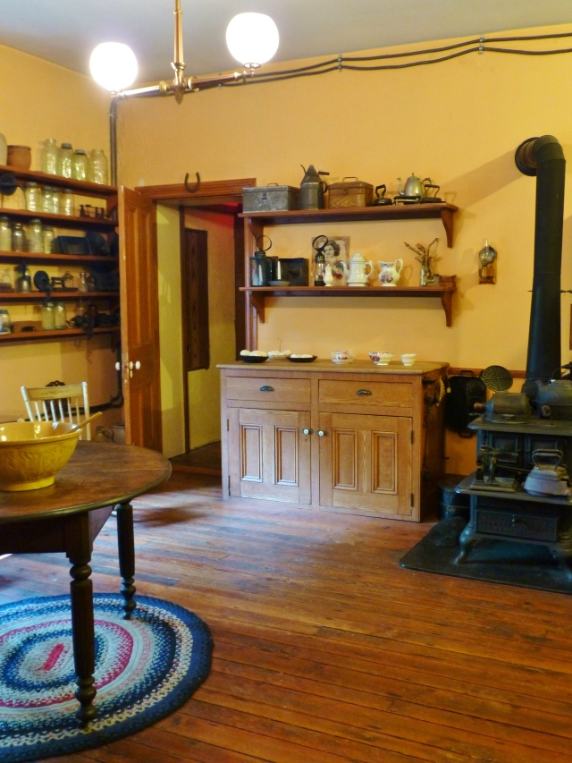 Upon entering the kitchen, the first thing you notice is the large black iron stove...I'm sure it got a lot of use, since the house was often very full, with 10-11 persons living there at one time!