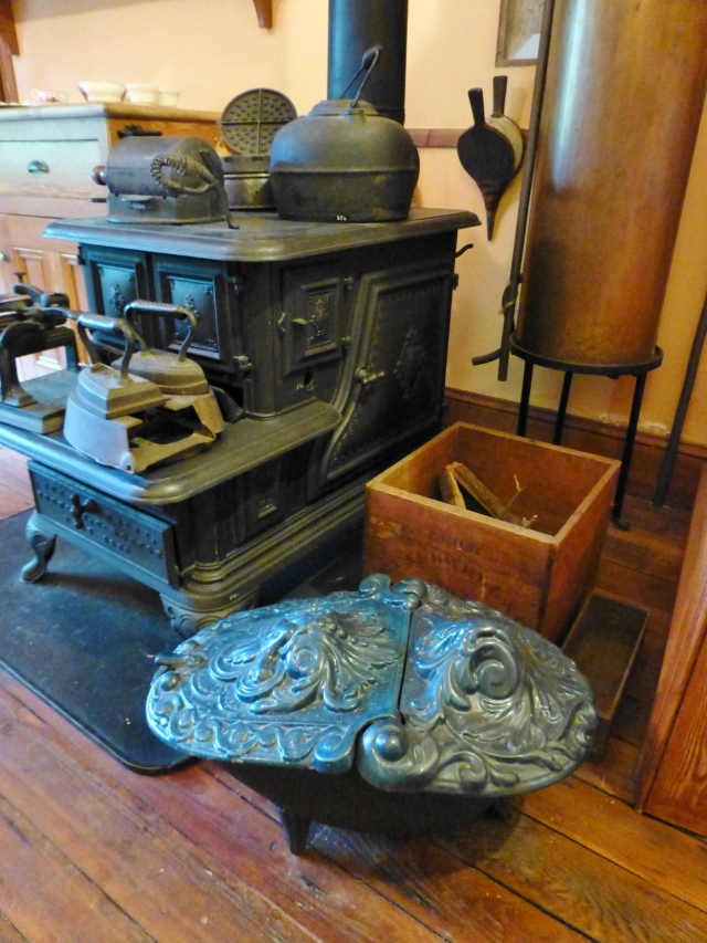 Isn't the coal scuttle at the bottom of this image pretty?  I love the deeply embossed, scrolled decorative lid.  I think it's wonderful that the Victorians embellished even the most basic and utilitarian items in the home.  Behind the coal scuttle, you'll notice the large hot water tank...this was high-tech gadgetry for the Victorians!