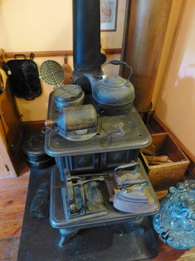 Here's a detail of the sturdy black iron stove, topped with many Victorian kitchen accoutrements.