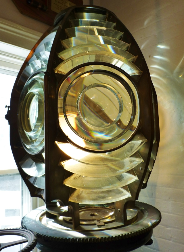 Here's an example of a lighthouse lens with prisms on display in the museum.  Isn't it beautiful?  This is how the light becomes amplified and is visible to boats very far away.