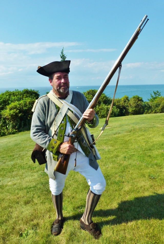 Each gentleman creates his own attire.  I particularly liked the striped stockings and bright green wool trim on this man's costume.  Can you see how big that musket is?  They are heavy!!