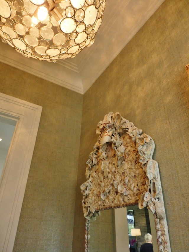 The powder room off the entry had a charming globe-shaped chandelier with rings of crystal and capiz shells.  The mirror over the sink vanity featured artfully arranged seashells.