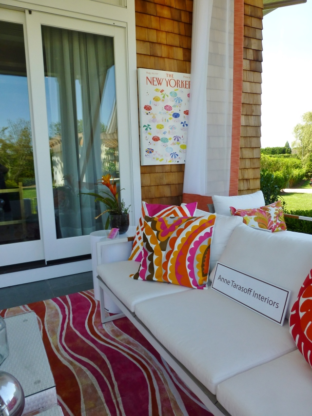 The designers, Gail and Karyn, used bold colorful accessories with crisp white outdoor furniture for this comfy sitting room.