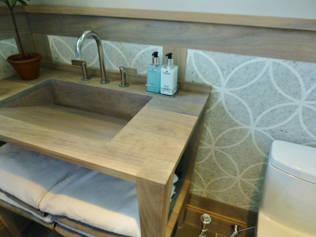 The wood vanity was so cool in this bathroom.  I just loved the beachy bleached finish and the extremely simple lines of everything.  It's also great how the woodwork on the walls coordinate with the custom sink base.