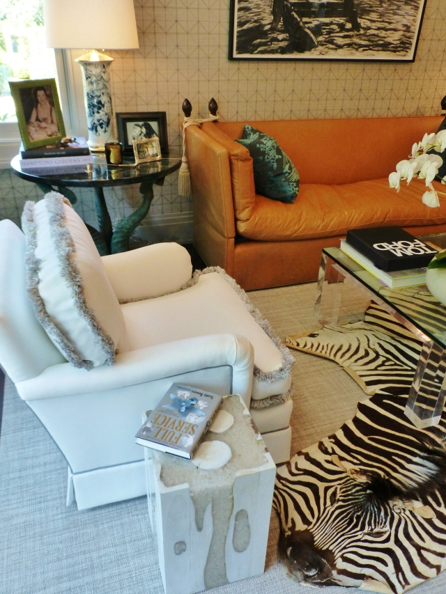 The ivory club chairs feature brush fringe along the cushion seams.  Notice the sisal area rug is layered with a real Zebra hide rug.  Animal skins were a popular recurring theme in this year's designer showhouse.