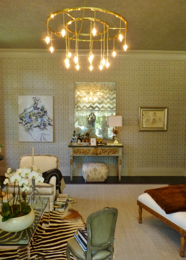 Across the room is an ornate, painted and gilded console table with an antiqued mirror above.  Beautiful antiqued mirrors were another recurring motif at the 2014 Hampton Designer Showhouse.