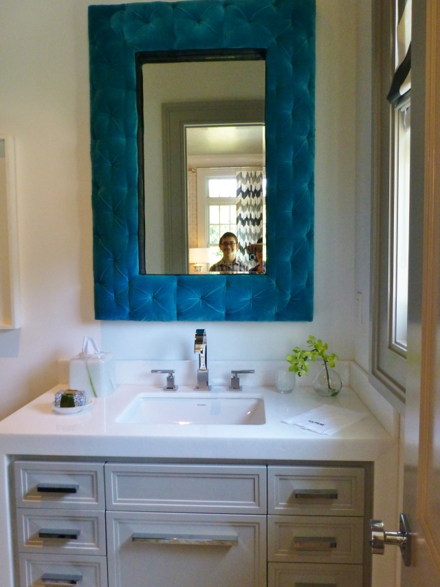 The bathroom mirror was wonderful!  It has a teal tufted velvet frame, which softens all the hard surfaces in this space.  The reflection shows the chevron draperies in the library, and my wonderful son, Grady too!  We have such fun touring these properties together.