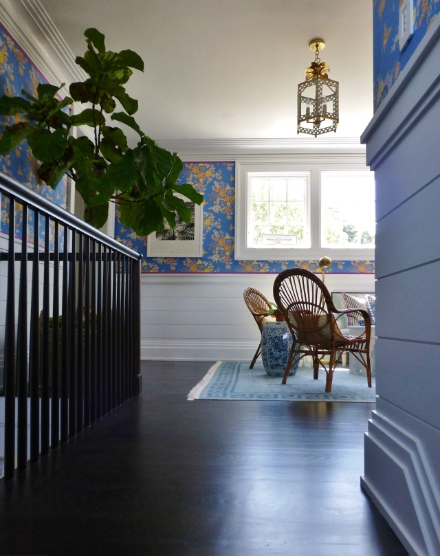 Climbing the stairs, you are greeted by the light streaming through the windows in the second floor stair landing, highlighting the gleaming hardwood floors.  One of the first things you'll notice is the gorgeous floral fabric upholstering the walls above the ship-lap wainscoting.