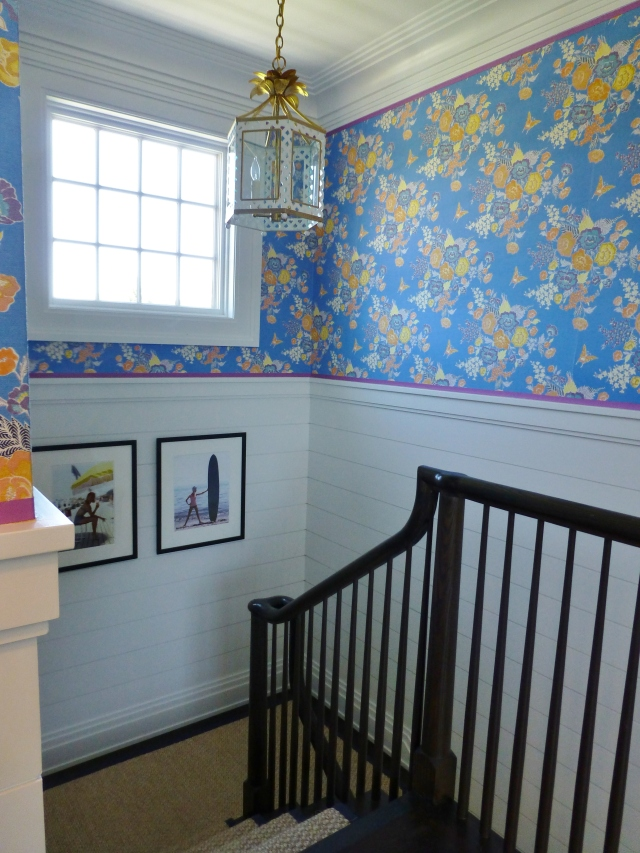 Looking back at the staircase, you'll notice the simple sisal carpet runner, the cute beach photography and that adorable vintage looking trellis-style lantern (one of a pair in the space).