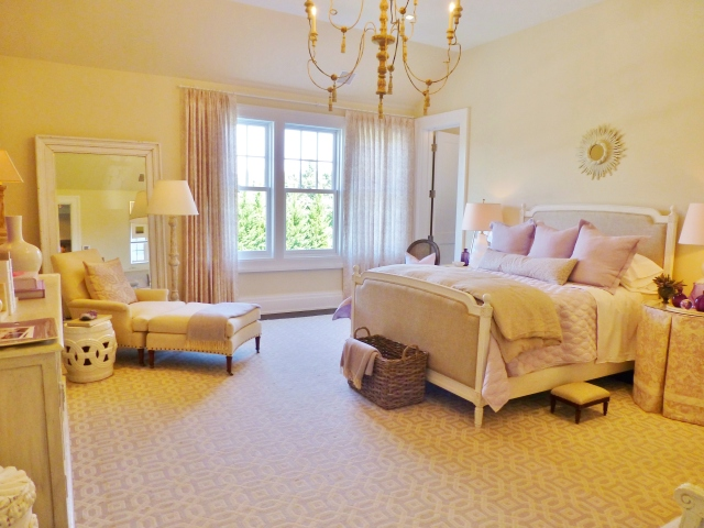 "Kate Singer is quoted as saying, ""I wanted this bedroom to have a peaceful, tranquil feel inspired by the soft and serene color palette of summer lilacs, linen and white.  This would be a wonderful room in which to retire at the end of a day at the beach or shopping in town."""