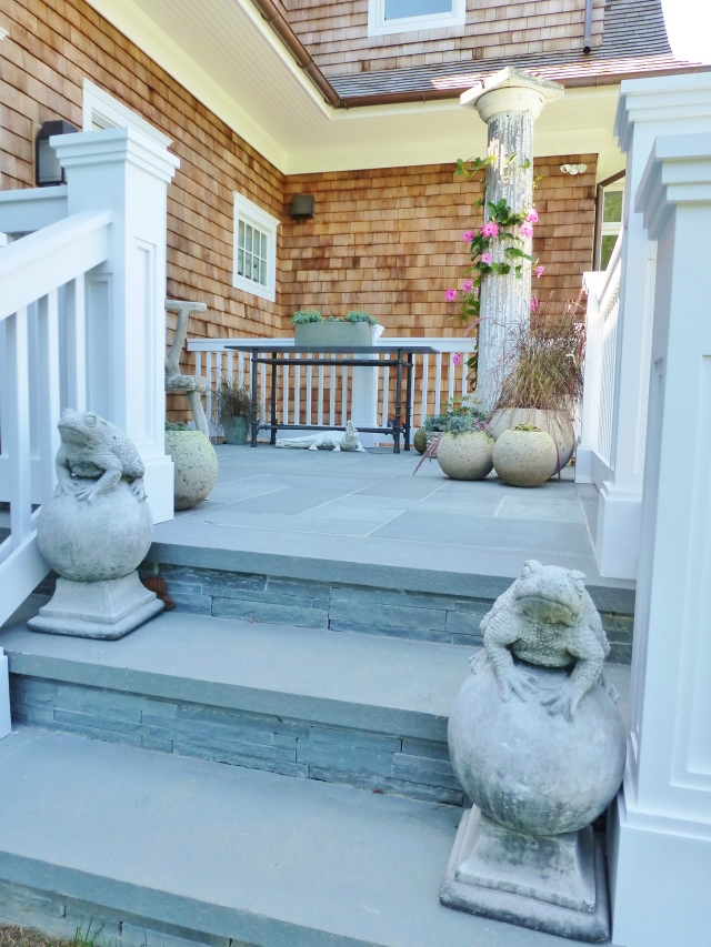 This is another area designed by Mecox Gardens.  Many traditional garden elements were used, like the cement frog statuary on the bluestone steps.  A primitive antique vintage Grecian column anchors the corner ahead.