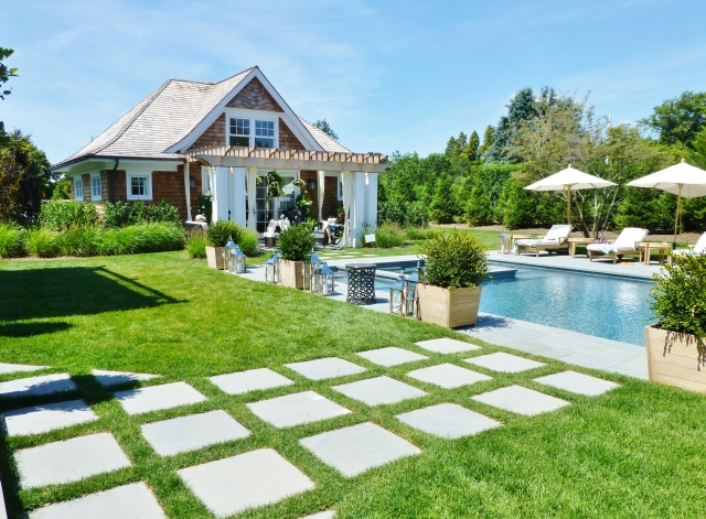 The adorable pool house and guest cottage has an elegant terrace all its own.