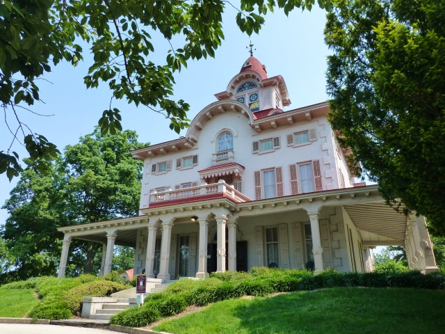 The mansion is a spectacular architectural specimen with it's huge wrap around porch and amazing cupola, complete with stained glass windows and decorative weathervane.