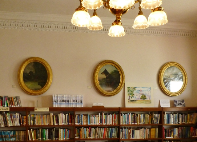 This photo shows the children's department, with some of the historic pet portraits displayed above the shelves.