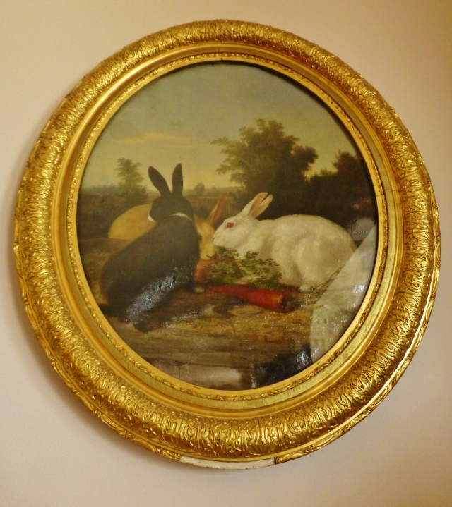 Dogs were by no means the only treasured companion in this family, as this portrait of two bunnies shows.