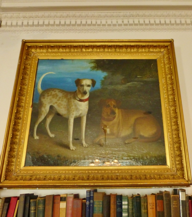 "Inside the museum are portraits of many family pets, including this 1884 oil on canvas painting by J.N. Ness entitled ""Ponto and Brown Dog""."