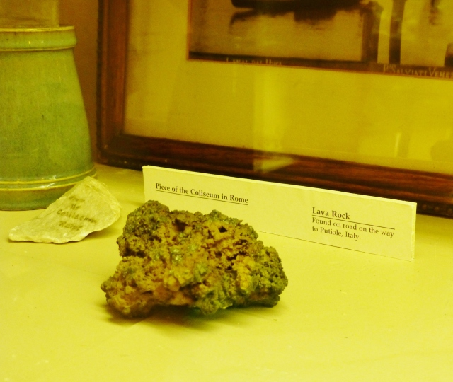 The objects in the cases are widely varied.  For instance, this image is of an ancient lava rock and a fragment of the Coliseum in Rome.