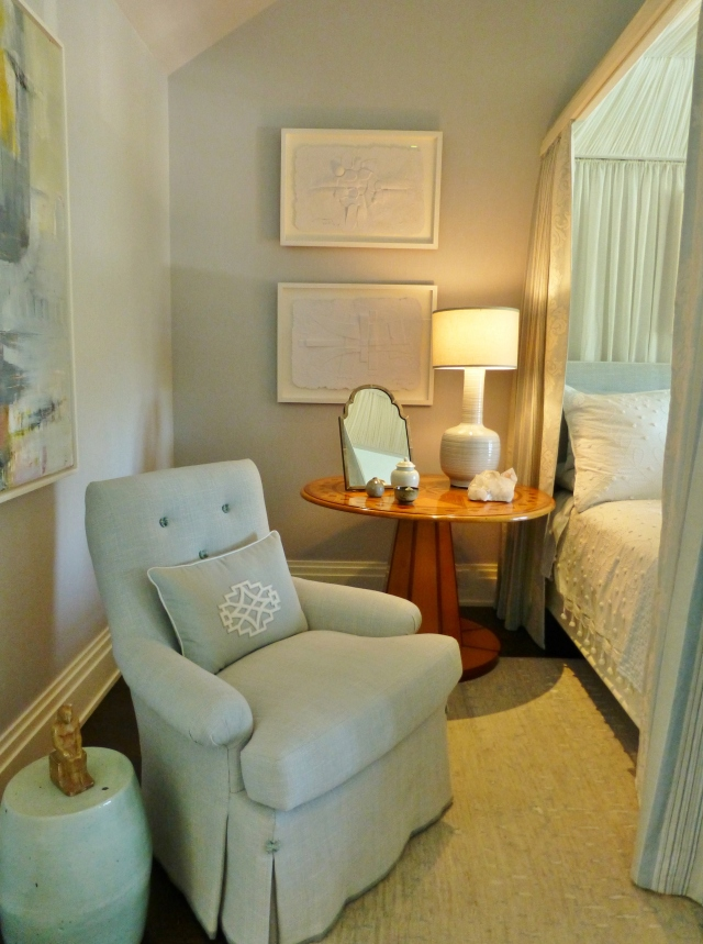 To the left of the bed, and just inside the door is a tailored, yet comfy chair, covered in soft blue linen with kick pleats on the waterfall skirt.   The pillow features a white geometric applique.   And I'm sure you've already noticed that terrific garden stool/drinks table beside the chair--I just love those!