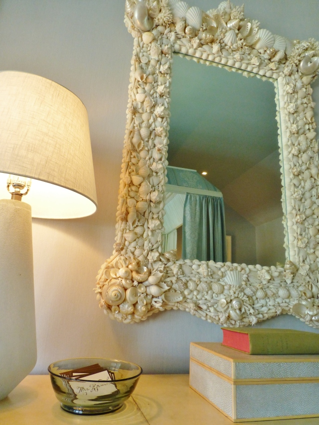 Here's a closeup on top of the dresser.  Check out that amazing seashell mirror!   I also love the limited use of tailored accessories in here--that Shagreen box is gorgeous!