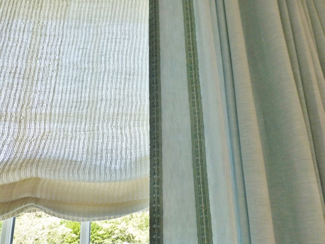 Here is a detail of the fabrics and trims on the sumptuous window treatments in this elegant bedroom.