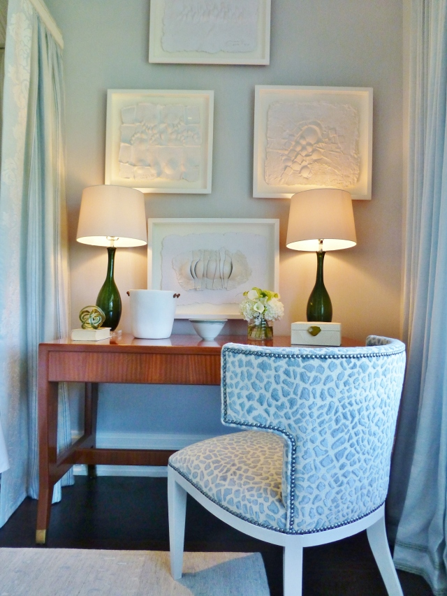 On the opposite side of the bed, Phoebe Howard chose to use a desk, instead of a traditional nite-stand.  I love this tactic and use it all the time, myself.  Desks are so functional and can also be used as dressing tables in a bedroom. The upholstered chair softens the dark wood of the desk.  Notice a pair of green glass lamps were used on the desk.  This was an unusual choice and a departure from the very limited color palette, but I loved it!  Green goes with everything.