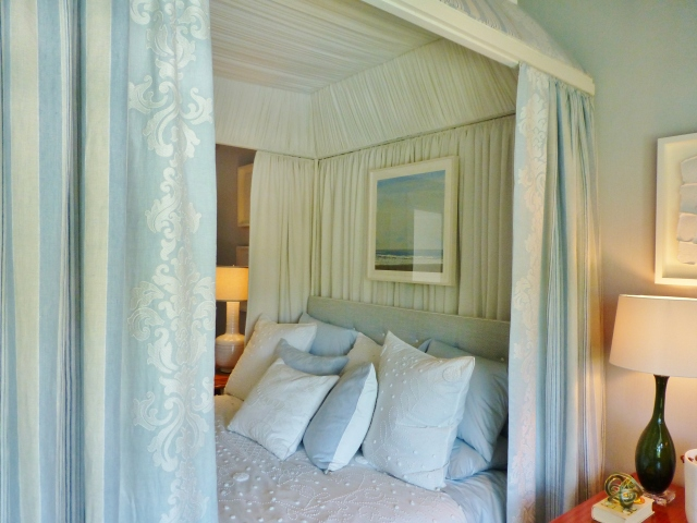The amazing canopy bed is a cocoon of soft white textures.  I love the bedspread.  Can you see the panels on the bedhangings, and the amazing pearlescent embroidery work?