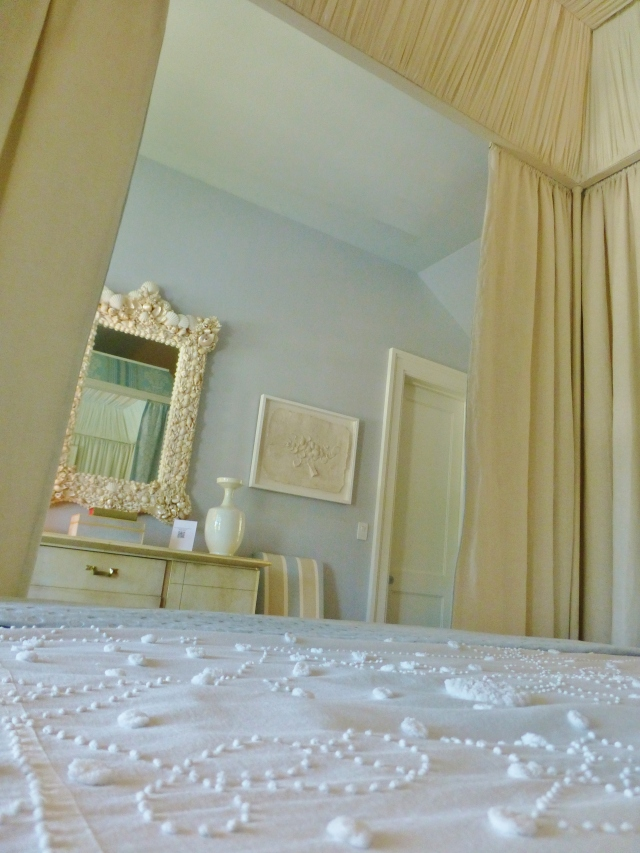 Here's a view from inside the bed (no I didn't climb under the covers, but I would've liked to!).  Notice the soft blue walls and the painted ivory dresser.  So elegant and understated!
