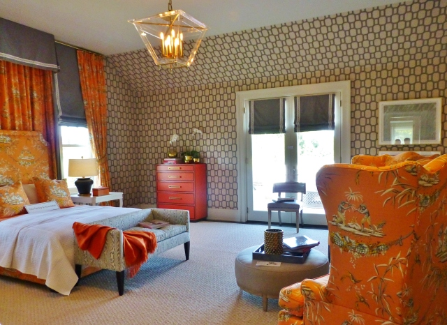 This is the view upon entering the master bedroom at the 2014 Hampton Designer Showhouse.  The bed with it's sumptuous half tester canopy is the obvious focal point (as it should be).  A strong grey fabric is used on the exterior, while a bold orange toile in an Asian inspired pattern lines the canopy.