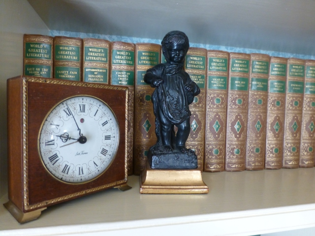 This vintage wood example looks pretty, paired with a Borghese figurine placed in front of a large set of 'The World's Greatest Literature'.