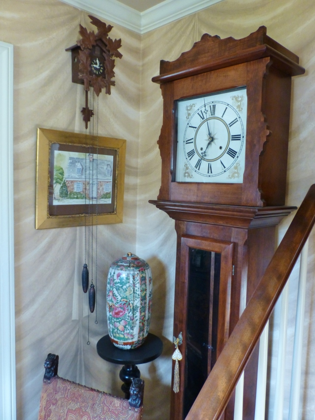 This is the grandfather clock that my husband refinished and restored many years ago.  It stands in our foyer, along with a cuckoo clock and a watercolor (done by my uncle) of our little cottage.