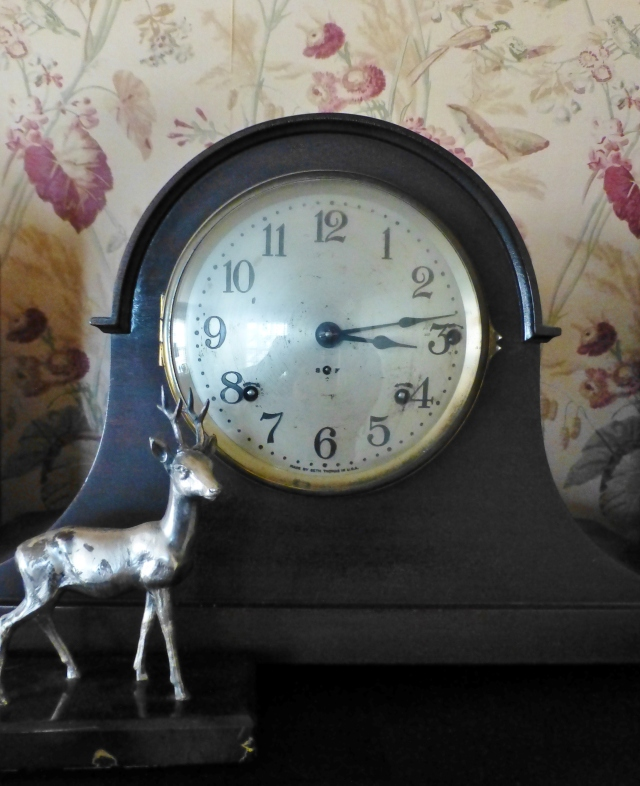 This 'camel back' mantel clock was a wedding gift from myself to my husband.   It has lovely Westminster chimes which ring every quarter hour.