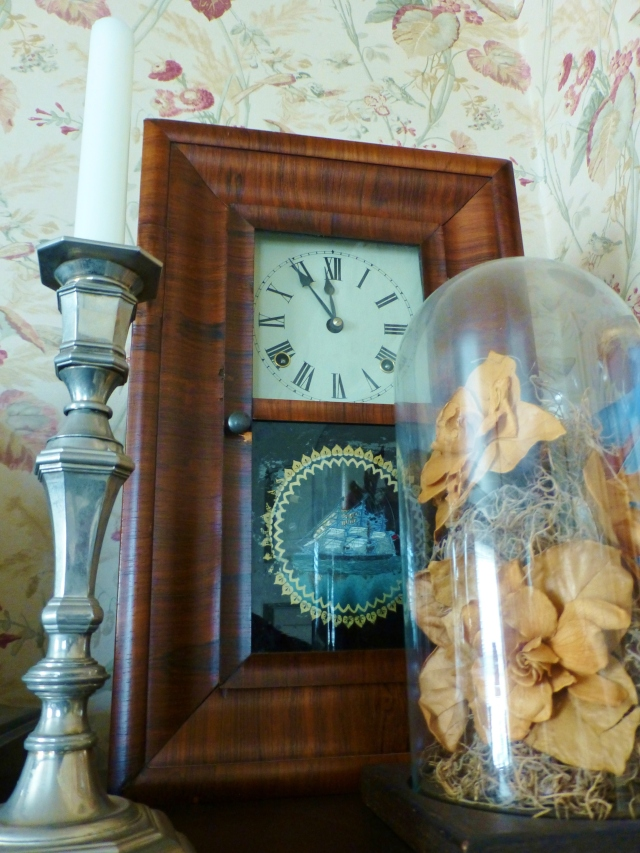 This 'shelf clock' with a reverse painted glass was a gift from my wonderful parents. The cloche holds dried gardenias from my own wedding bouquet.