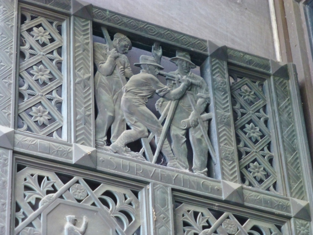 A detail of the surveying panel on one of the bronze doors at the Pennsylvania State Capitol Building in Harrisburg.