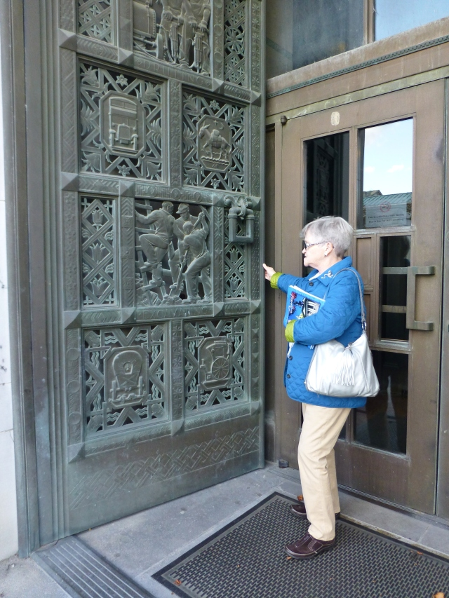 This is my Mom standing in front of an amazingly detailed door at the capitol building.   The door had different professions featured on different panels, placed in a grid, almost like a quilt.   The workmanship here is just phenomenal!
