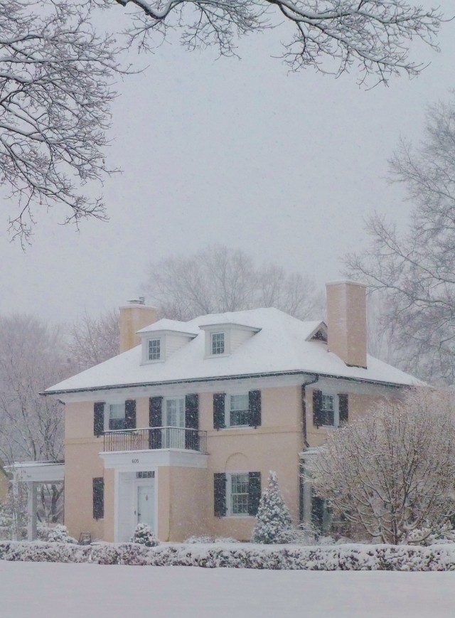 This pale pink Mediterranean house is lovely against the white snow.  This pastel color is so pretty!
