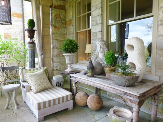 Barry Dixon's back porch contains an amazing variety of garden statuary, accessories and many examples of his own furniture line.  It must be so wonderful to lounge out here, taking in the view of the grounds at Elway Hall in the summertime!