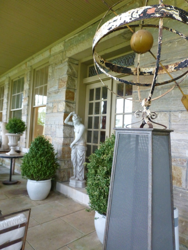 Here are the entry doors leading inside the home.  A Grecian statue is perfect in the doorway, and a mesh pedestal elevates a rustic garden armillary sphere.  The metal mesh pedestal is one of Barry's own designs!