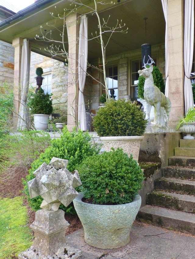 Here's a view of the opposite side of the stairs leading up to the terrace.  Grady especially liked the orb statue in the foreground.  I love the simplicity of the boxwood shrubbery in those big stone pots.  They allow the garden sculptures to be the stars!