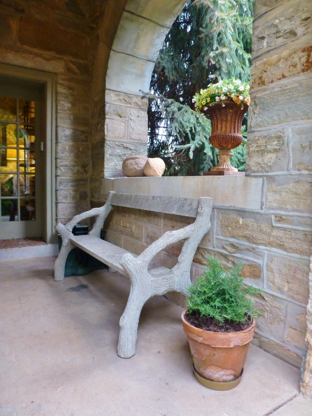 My final image is from a little side porch off the front of Elway Hall.  I thought the stone faux bois bench was so charming centered under the archway.  And the giant nut sculpture sitting up on the ledge is fantastic too!