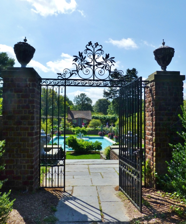 The absolutely stunning gates leading to the pool garden at Planting Fields.   The brick columns, topped with decorative urns, provide a stately feel to the pool area.
