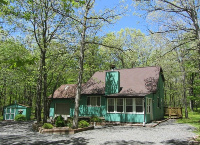 "Here is the same photo in full living color! Our little mountain house is painted, what I like to call, Swimming Pool Green. Truly, when we were shopping for a mountain house, I skipped past this one, solely because of the color. It was my husband who said, ""This one has everything we want, let's go take a look."""