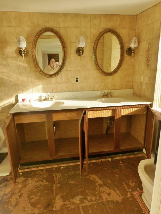 Upon entering the bathroom, visitors are confronted with this wide, double-vanity. The homeowner is planning to have this vanity base painted, and new countertops, sinks, and fittings will be installed. The vanity mirrors will remain, albeit with a new finish as well. All the wall tiles will be demolished and new floors will be installed.