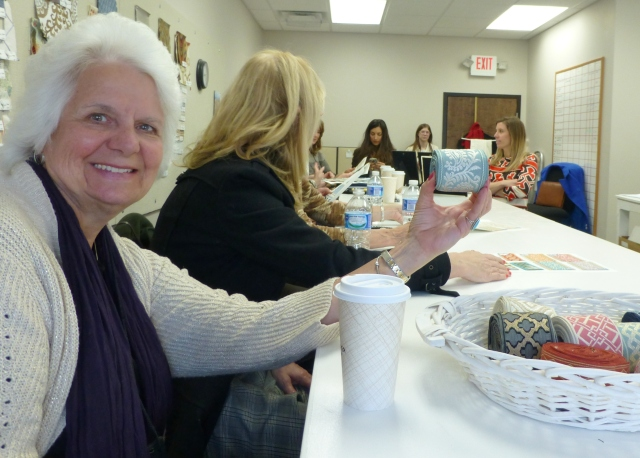Grace Rumer, of Grace Irene Window Fashions, and I are active participants in our WCAA (Window Coverings Association of America) group. Here's a photo of Grace at one of our chapter meetings which was held at Stout Textiles last spring. What's amazing, is that Grace, who is providing all the custom bedding and drapery labor for my 2016 Bucks County Designer House Bedroom, is holding the very trim that I chose to feature in my room's design!