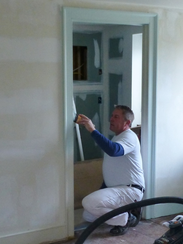 Here's a photo of Michael Howard, of The Perfect Hangup, beginning the painting in my Bucks County Designer House bedroom. I'm so excited to see the transformation finally begin!