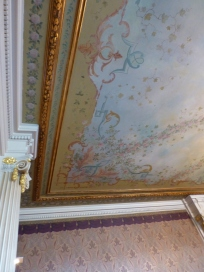 So much detail and I love the feminine colors and faded effect of the floral design on this particular ceiling!