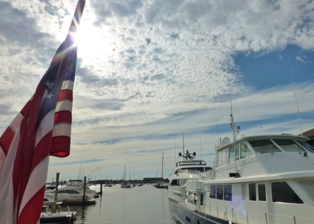 American Flag and boats in the harbor of Newport RI